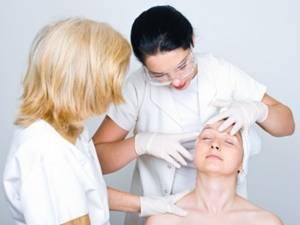 dermatologist examining facial zones